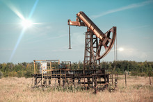 Abandoned Pump Jack On An Abandoned Oil Field