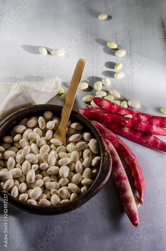 beans in clay basil on a table with ingredients for preparation Canvas-taulu