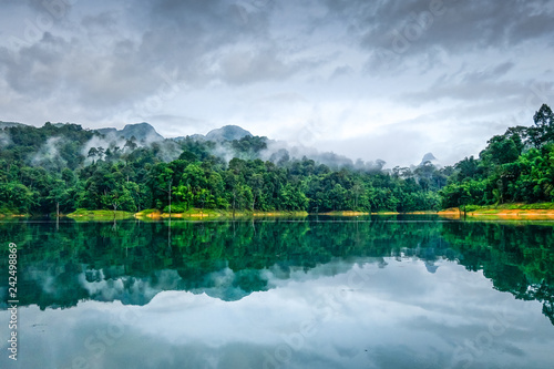 Tuinposter Asia land Misty morning on Cheow Lan Lake, Khao Sok National Park, Thailand