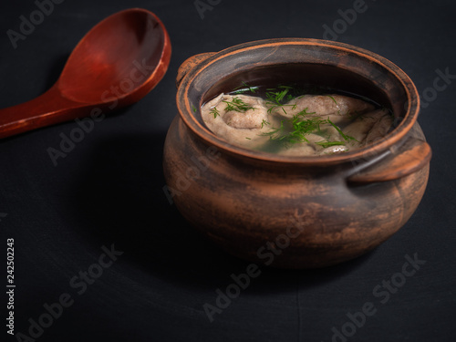 Fotografie, Obraz  Hot lunch of pelens in a rustic clay pot and a large wooden spoon