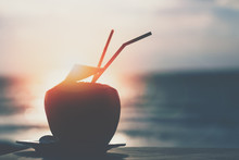 Coconut Juice On The Beach With Sunset. Ens Flare Effect.