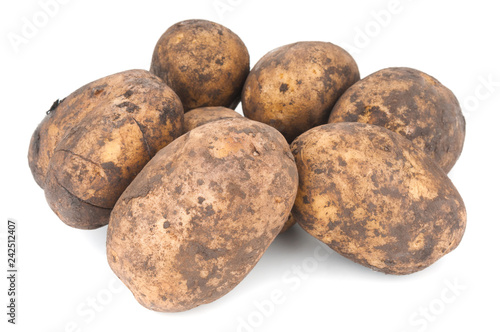 Heap of fresh organic potatoes on white background