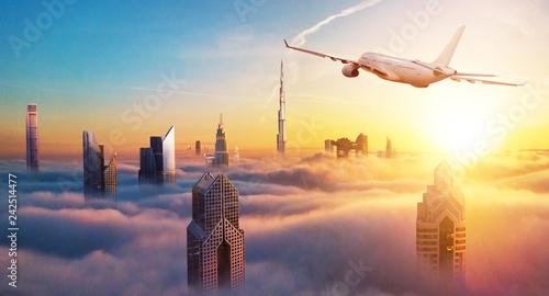 Keuken foto achterwand Stad gebouw Private jet plane flying above Dubai city
