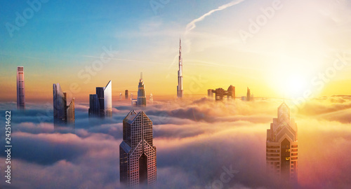 Slika na platnu Dubai sunset view of downtown covered with clouds
