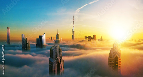Poster Zwavel geel Dubai sunset view of downtown covered with clouds