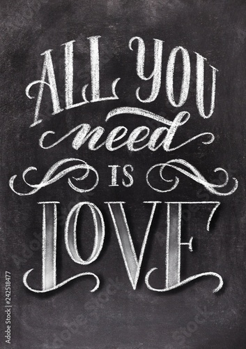 Photo  All you need is love hand drawn chalk lettering on chalkboard background
