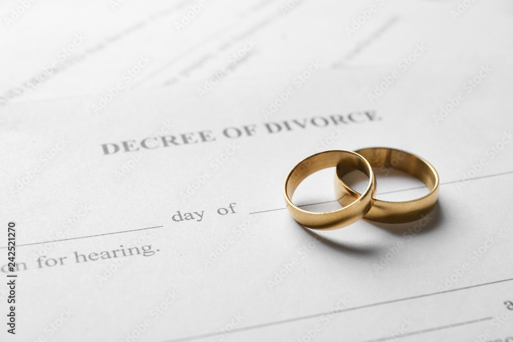 Fototapety, obrazy: Rings with decree of divorce, closeup
