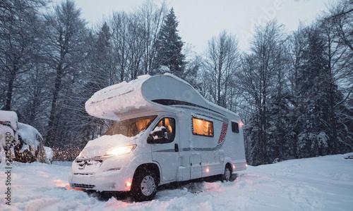 Obraz na plátně  motorhome camper van in the nature, nomad van life for traveler in the winter ho