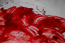 Pool Of Blood On Tiled Floor