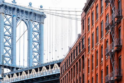Photo  Bridge and brick industrial buildings