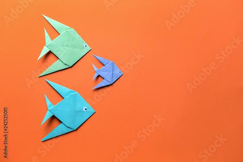 Obraz na plátně  Origami fish on color background