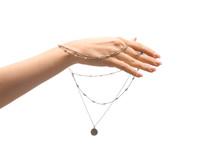 Female Hand With Stylish Necklace On White Background
