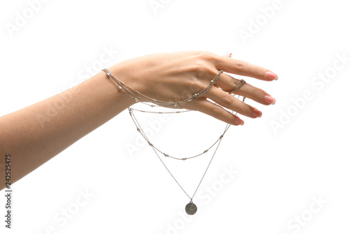 Foto Female hand with stylish necklace on white background