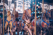 A Young Woman Rides A Merry-go...