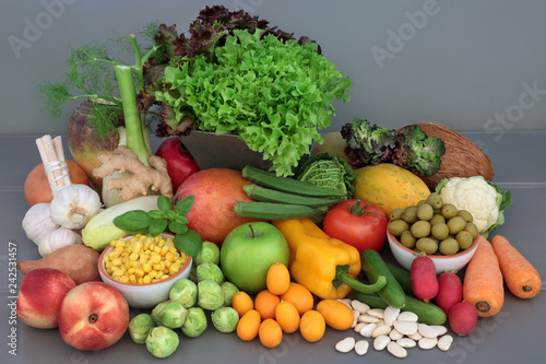 Alkaline health food of fresh vegetables, fruit, herbs, spice and dried legumes on grey wood table background Canvas Print