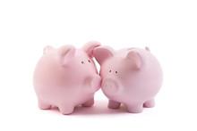 Two Piggy Banks On White Backg...