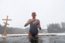 Girl In A Swimsuit Dipped In The Hole In The Winter. Orthodox Feast Of The Baptism Of The