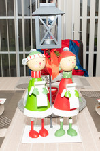 Modern Family Christmas Table With Carol Singing Ornaments