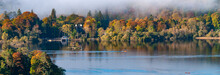 Panorama Of Cloud Over Derwent Water Lake, Lake District Cumbria With Autumn Colours And Clear Water.Cloud Over Derwent Water Lake In The Lake District Cumbria With Autumn Colours And Clear Water.