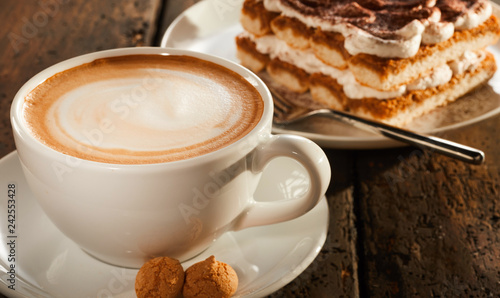 Obraz White ceramic cup of coffee with dessert - fototapety do salonu