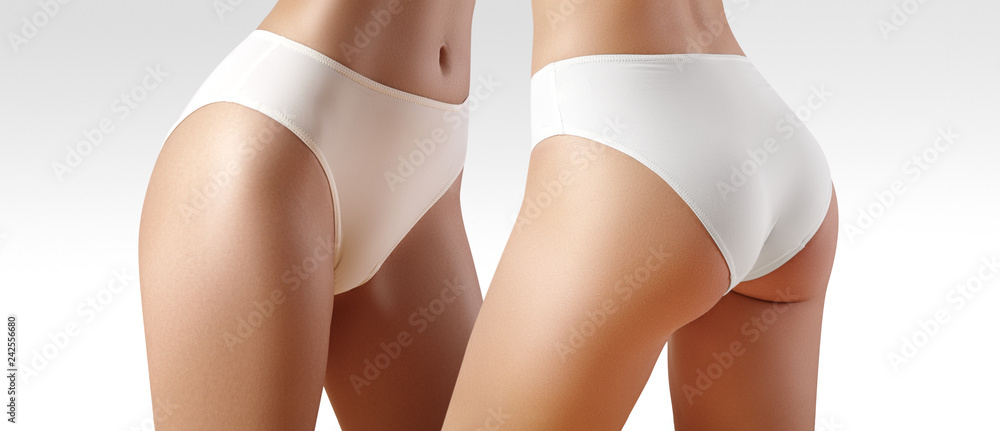 Fototapety, obrazy: Spa and wellness. Healthy slim body in white panties. Beautiful sexy hips with clean skin. Fitness or plastic surgery.