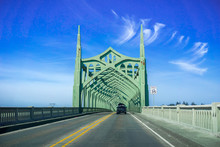 Driving On The Conde B. McCullough Memorial Bridge, Oregon, Formerly The Coos Bay Bridge, On A Sunny Day