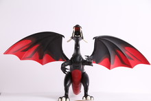 Black And Red Dragon Toy On White Background