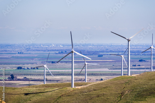 Fotografie, Obraz  Wind turbines on the hills of east San Francisco bay, Stockton valley in the bac