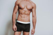 Close Up Of Muscular Man Standing In Black Underwear