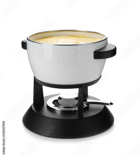Pot with delicious cheese fondue on white background