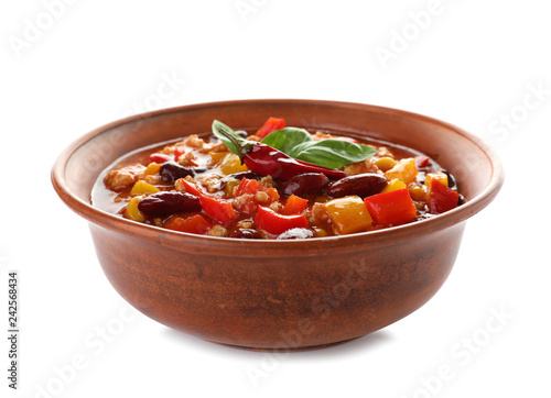 Bowl with tasty chili con carne on white background