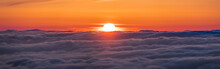 Panoramic View Of A Fiery Sunset Over A Sea Of Clouds Covering San Francisco Bay Area, California