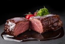 Sliced Pork Steak In Teriyaki Sauce On Black Stone