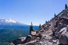 Hiking Trail In Siskiyou County; Shasta Mountain Covered In Snow Visible On The Left; Northern California