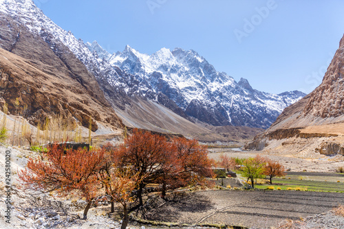Tuinposter Asia land Beautiful autumn scene along Karakorum highway with layers of snow mountains and blue sky background