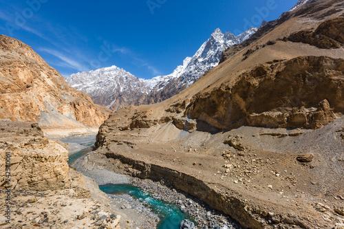 Keuken foto achterwand Asia land mountain lake under the sunny day with blue sky along Karakorum Highway in Passu, Hunza district of Pakistan