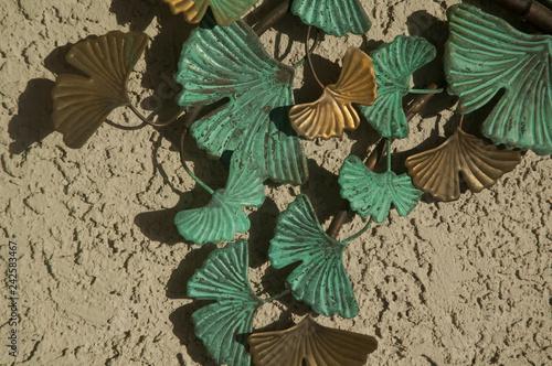 Fotografie, Obraz  Metal Leaves on Stucco Wall