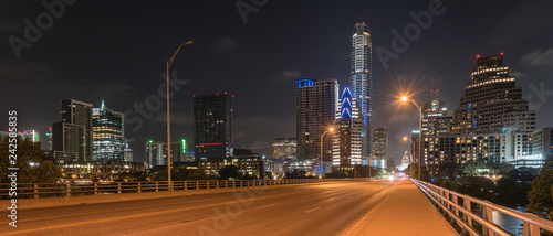Obraz na płótnie Panorama view downtown Austin at night with traffic light trail lead to Texas State capitol building