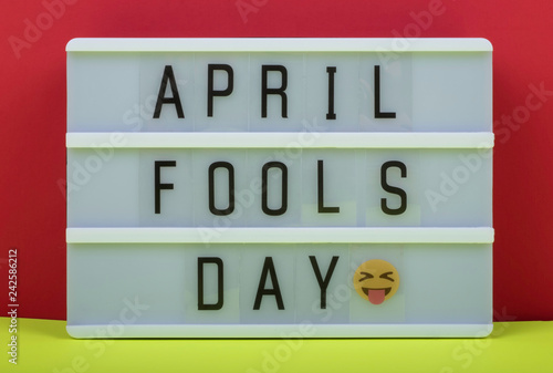 Fotografie, Obraz  April Fool's day lettering on Lightbox on Red and Yellow background