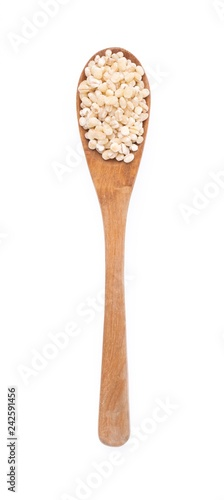 Fényképezés wood spoon of Barley rice isolated on white background