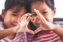 Two Cute Asian Child Girls Mak...