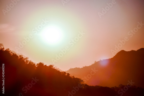 Tuinposter Baksteen sunset in the mountains, digital photo picture as a background
