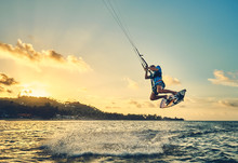 Young Man Kite Boarder Jumps O...