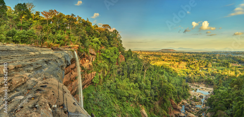 Wall Murals Forest river Beautiful waterfall flowing from the cliff in the tropical jungles panoramic top view