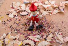 Pinocchio Sitting Amid Pencil...