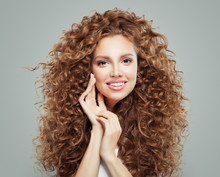 Young Happy Redhead Woman With Long Healthy Curly Hair. Hair Care Concept.