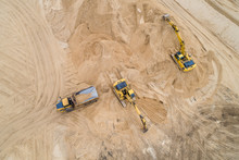 Loading Sand Excavator In A Dump Truck On The Construction Site