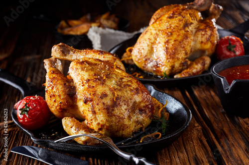 Photo  Two small roasted poussin or spring chickens