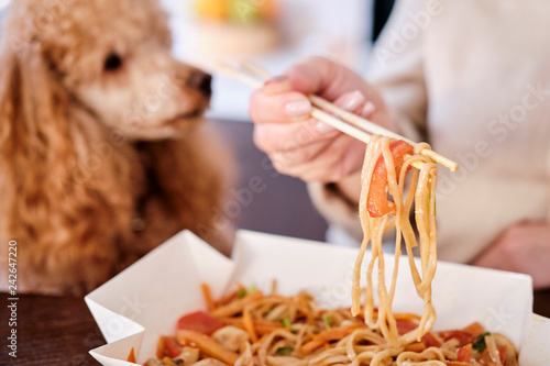 Woman enjoy japanese thai meal at home.  Concept of takeaway delivery service.