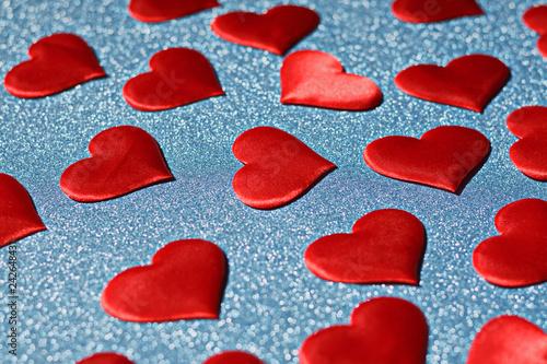 Fotografie, Obraz  Closeup of a red heart on a blue shiny background. Valentine's d